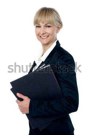 Pretty business woman ready to attend meeting Stock photo © stockyimages