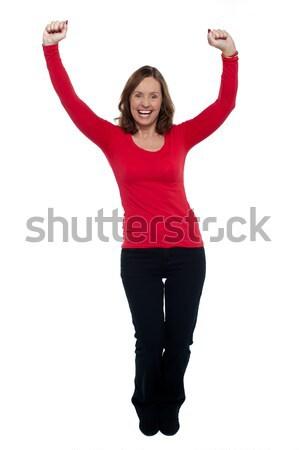 Jubilant lady celebrating her success Stock photo © stockyimages