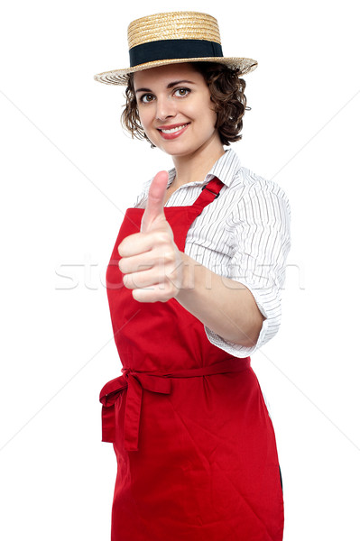 Stock photo: Young baker woman gesturing thumbs up