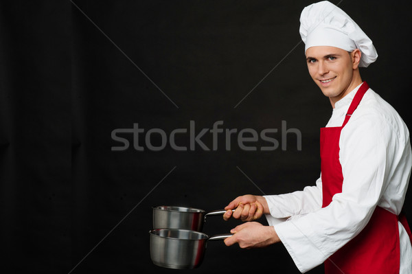 Young male chef holding empty vessels Stock photo © stockyimages
