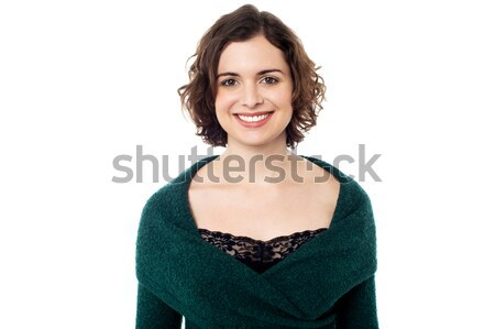 Pretty smiling model wearing trendy pullover Stock photo © stockyimages