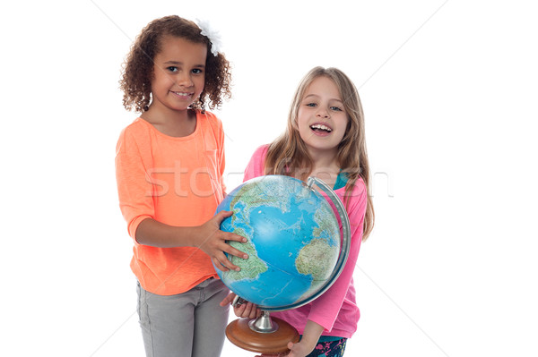 Little girls playing with globe Stock photo © stockyimages