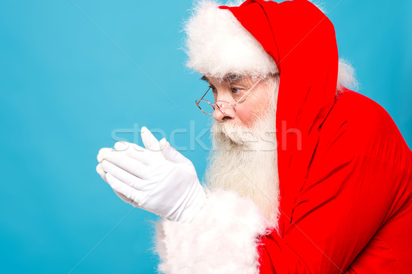 Santaclaus about to blow snow Stock photo © stockyimages