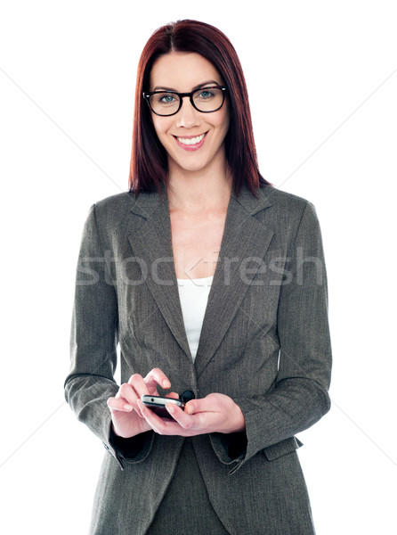 Female assistant using touch screen phone Stock photo © stockyimages