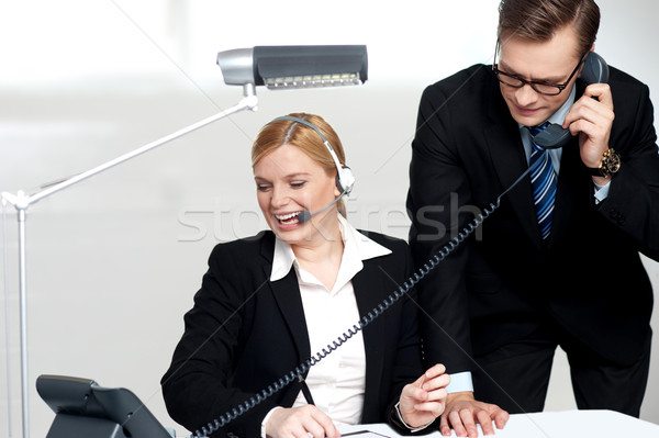 Male executive attending clients call Stock photo © stockyimages