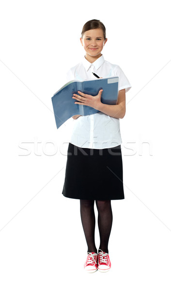 Stock photo: Full length portrait of smiling girl doing homework