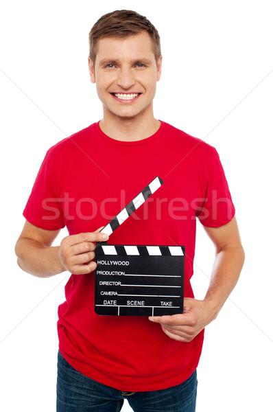 Glimlachend jonge vent scène Stockfoto © stockyimages