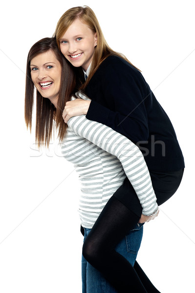 Fun loving duo of mother and daughter Stock photo © stockyimages