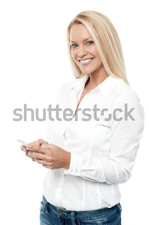 Fashionable young girl in pristine white t-shirt Stock photo © stockyimages