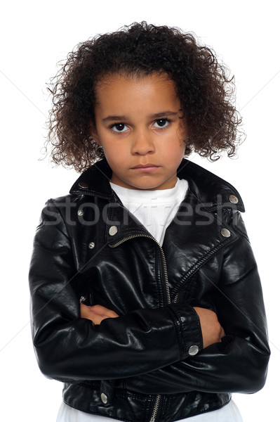 Melancholic girl posing with crossed arms Stock photo © stockyimages