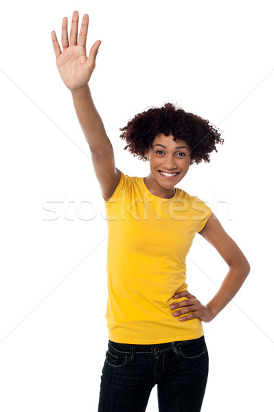 Stylish female waving her hand at you Stock photo © stockyimages