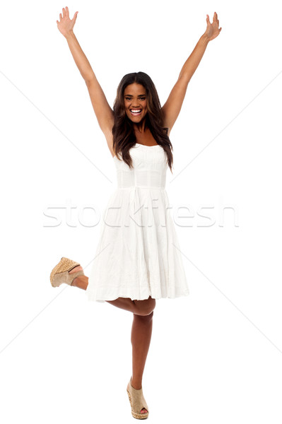 Excited girl raising her hands Stock photo © stockyimages