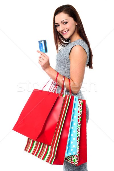 Fashionable female with shopping bags Stock photo © stockyimages