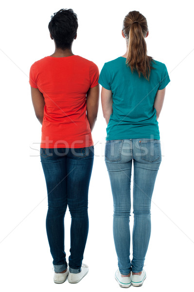 Females facing towards the wall Stock photo © stockyimages