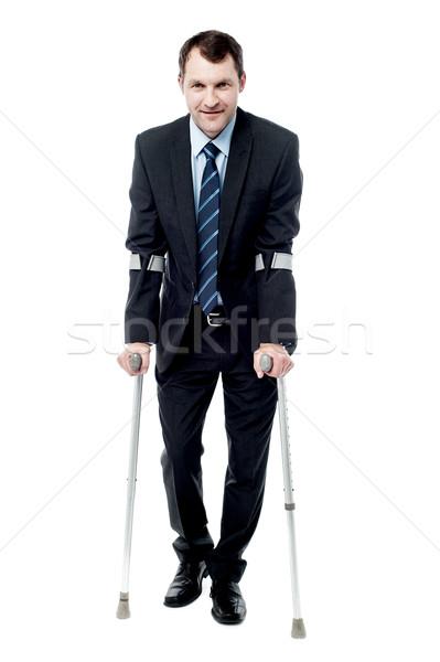 ビジネスマン 徒歩 松葉杖 ハンサム ビジネス スーツ ストックフォト © stockyimages