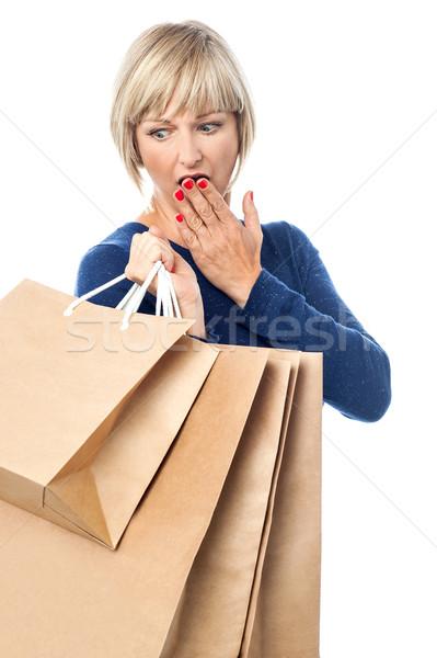 Amazed shopping woman isolated on white Stock photo © stockyimages