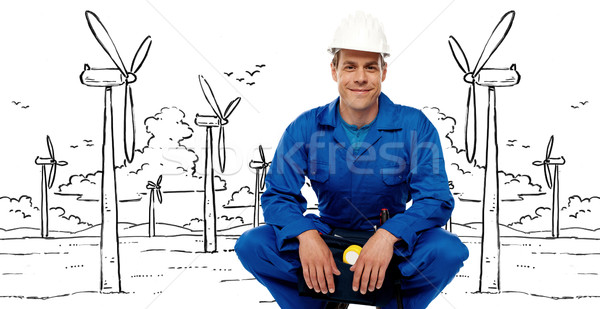 Construction worker against graphic background Stock photo © stockyimages