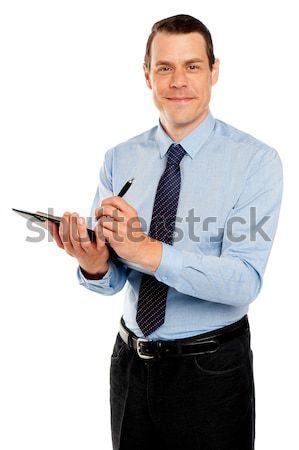 Happy senior manager posing with thumbs-up gesture Stock photo © stockyimages
