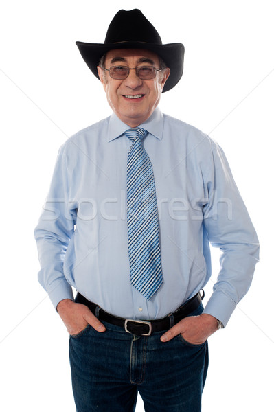 Portrait of a senior cowboy wearing hat Stock photo © stockyimages