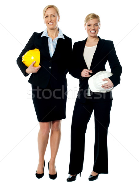 Portrait of two architects with helmets Stock photo © stockyimages