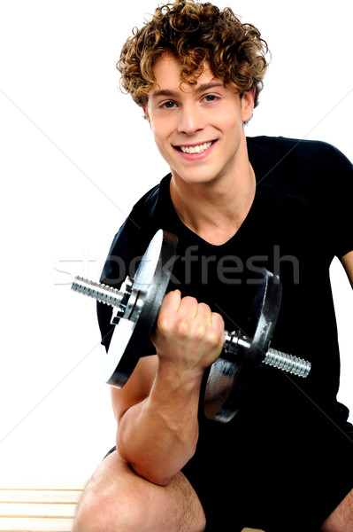 S'adapter entraîneur biceps exercice blanche sourire Photo stock © stockyimages