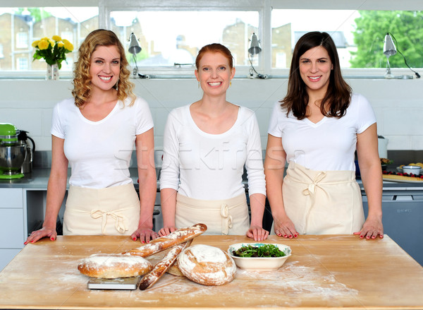 Group of young beautiful professional chefs Stock photo © stockyimages