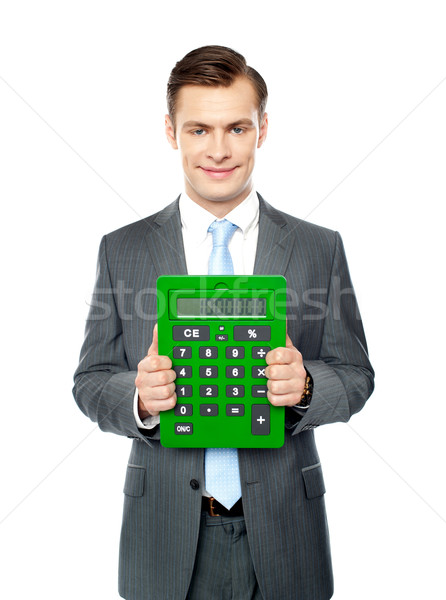 Corporate man showing big calculator Stock photo © stockyimages