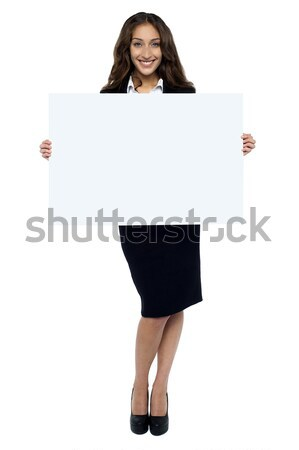 Corporate woman displaying blank whiteboard Stock photo © stockyimages