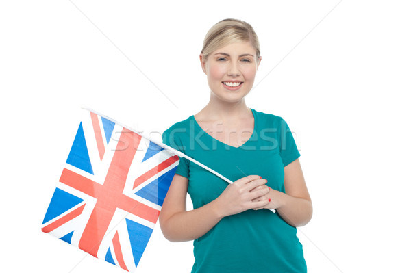 Young UK supporter holding national flag Stock photo © stockyimages