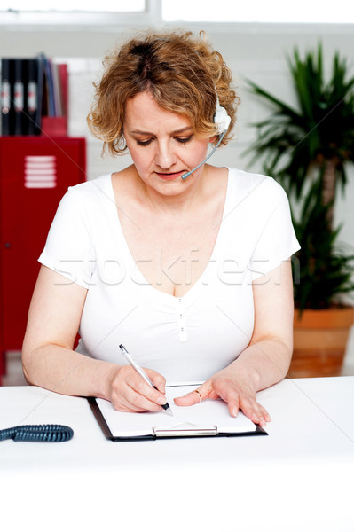 Businesswoman engrossed in her work Stock photo © stockyimages