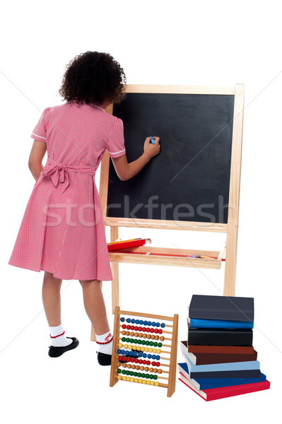 Rear view of school girl in maths class Stock photo © stockyimages