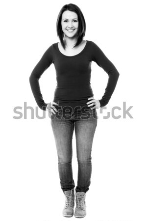 Fashionable girl with hands on waist Stock photo © stockyimages