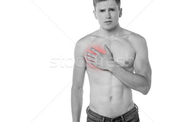 Young man having chest pain Stock photo © stockyimages