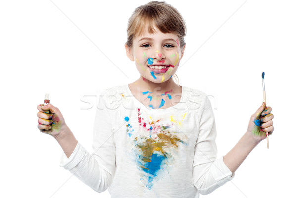 Cheerful kid with paint and brush Stock photo © stockyimages