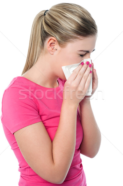 Young girl sneezing, suffering from cold Stock photo © stockyimages
