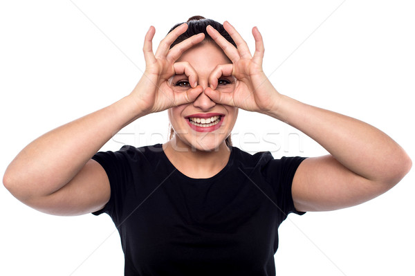 Cheerful woman in observe gesture Stock photo © stockyimages