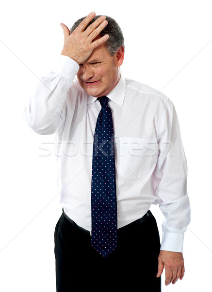 Sad old corporate man with hand on head Stock photo © stockyimages