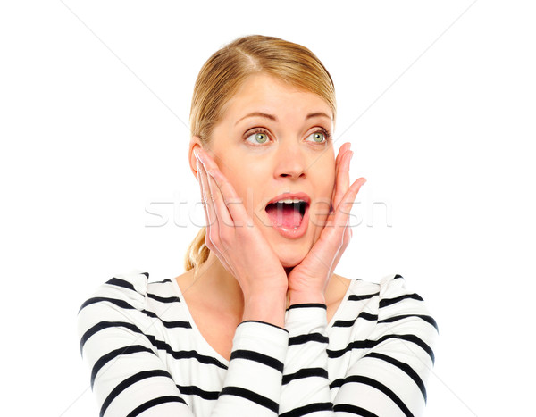 Surprised beautiful woman in casuals Stock photo © stockyimages