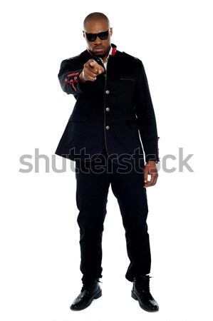 Portrait of fashion model pointing at you Stock photo © stockyimages