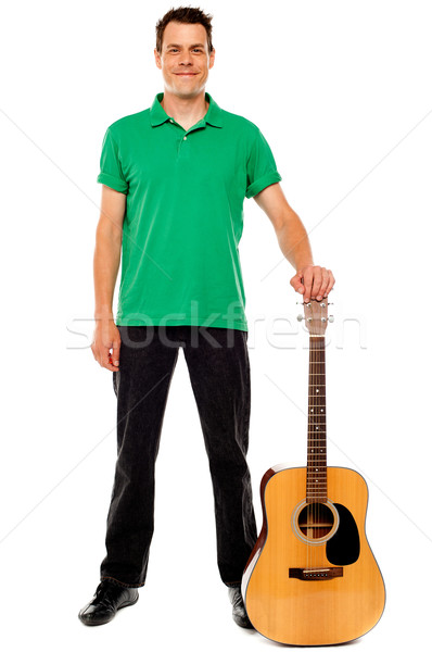 Young guitarist standing with guitar Stock photo © stockyimages