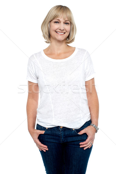 Middle aged woman in trendy clothing smiling at you Stock photo © stockyimages