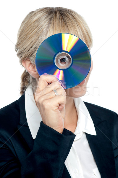Corporate lady looking through compact disc hole Stock photo © stockyimages