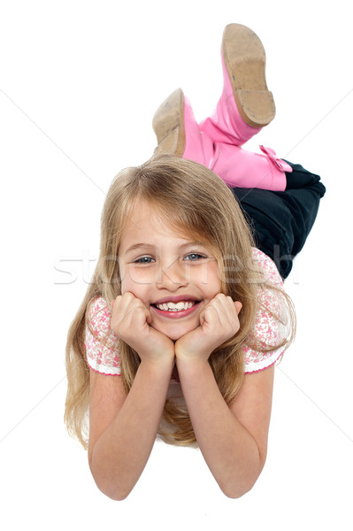Fashion kid lying on studio floor, relaxing Stock photo © stockyimages