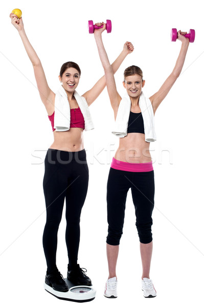 Two smiling girls working out together Stock photo © stockyimages