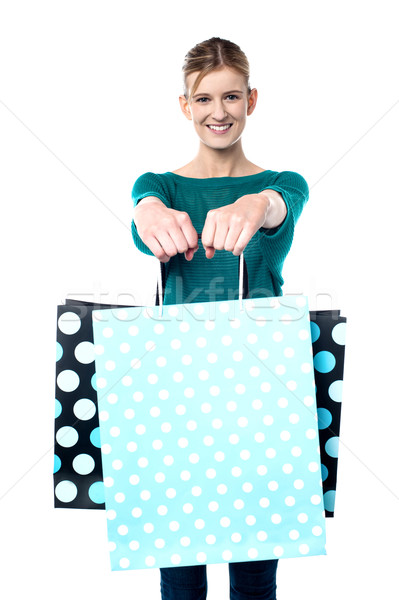 Young shopaholic girl with vibrant bags Stock photo © stockyimages
