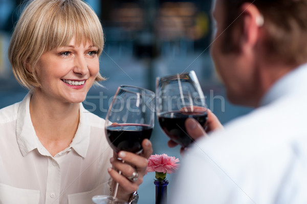 Couple toasting in a restaurant Stock photo © stockyimages