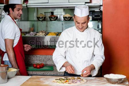 Chef preparing pizza base Stock photo © stockyimages