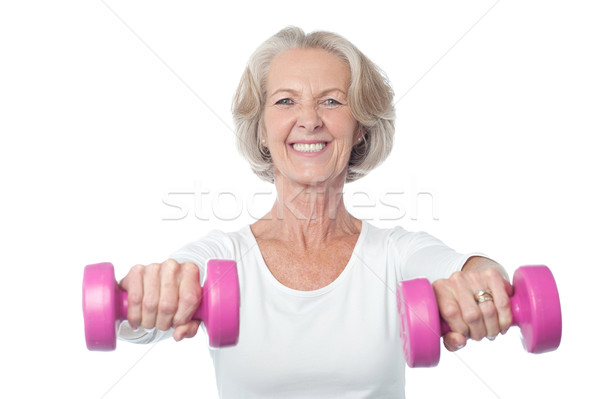 Happy aged woman exercising Stock photo © stockyimages