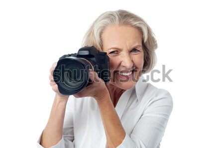 Fotoğrafçılık benim favori kıdemli kadın Stok fotoğraf © stockyimages