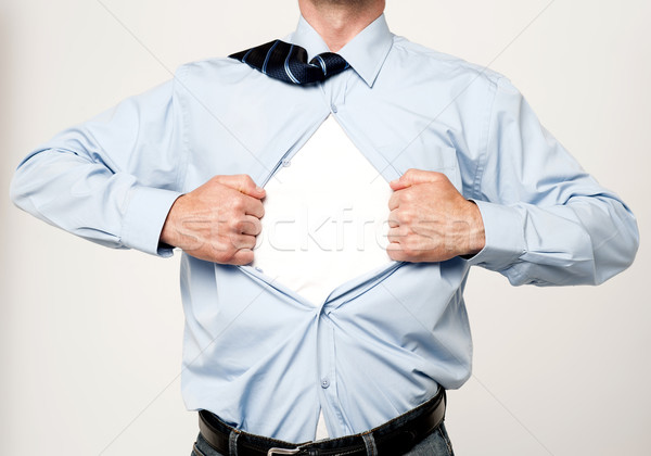 Stock photo: Superhero executive tearing his shirt